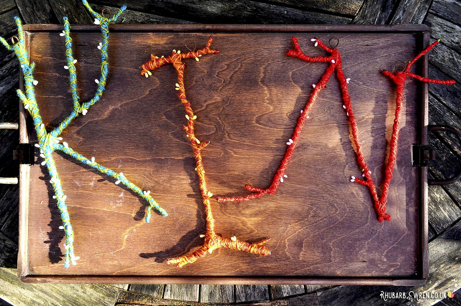 twig letters wrapped in wool or yarn