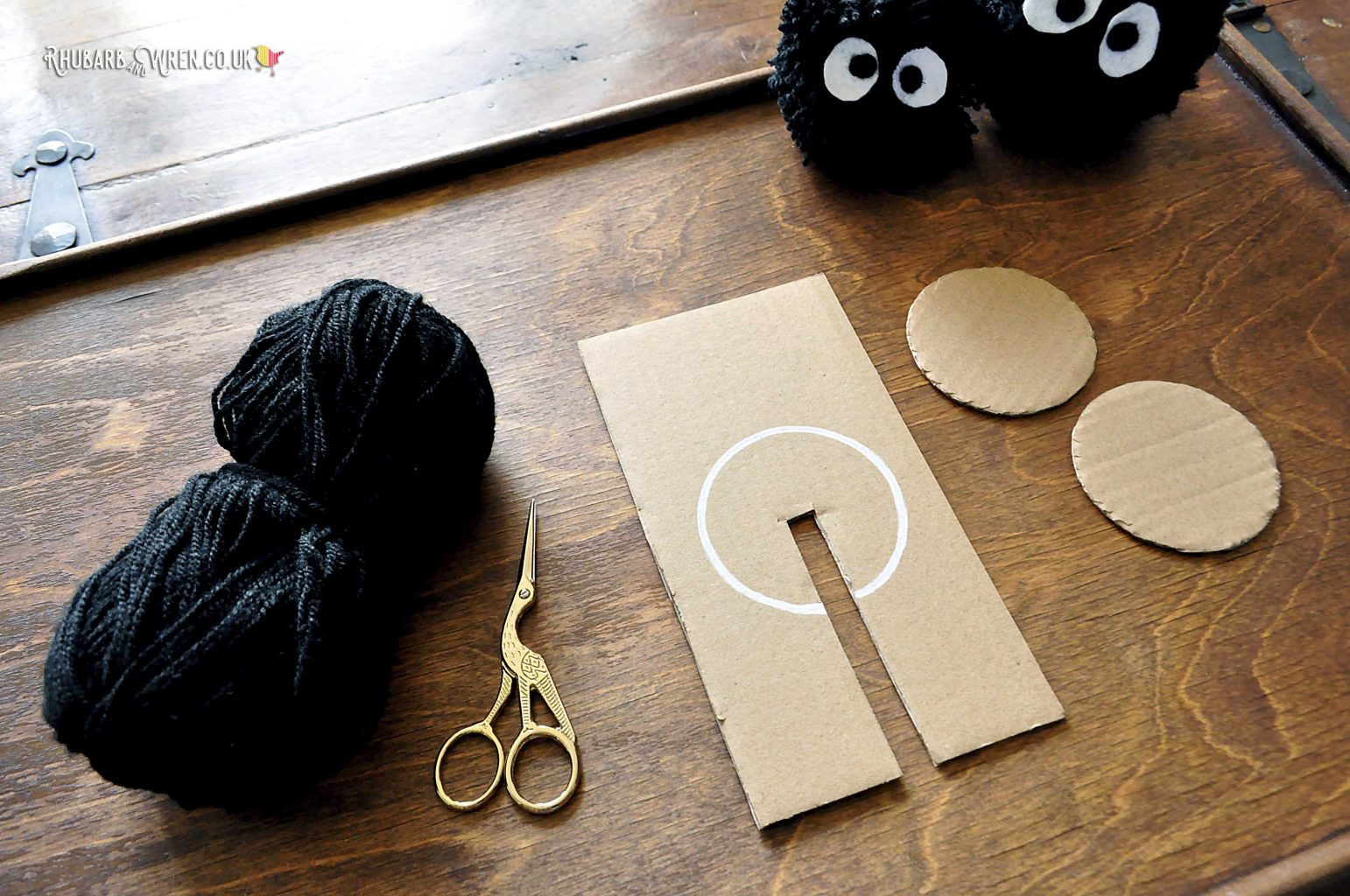 a home-made cardboard pompom maker