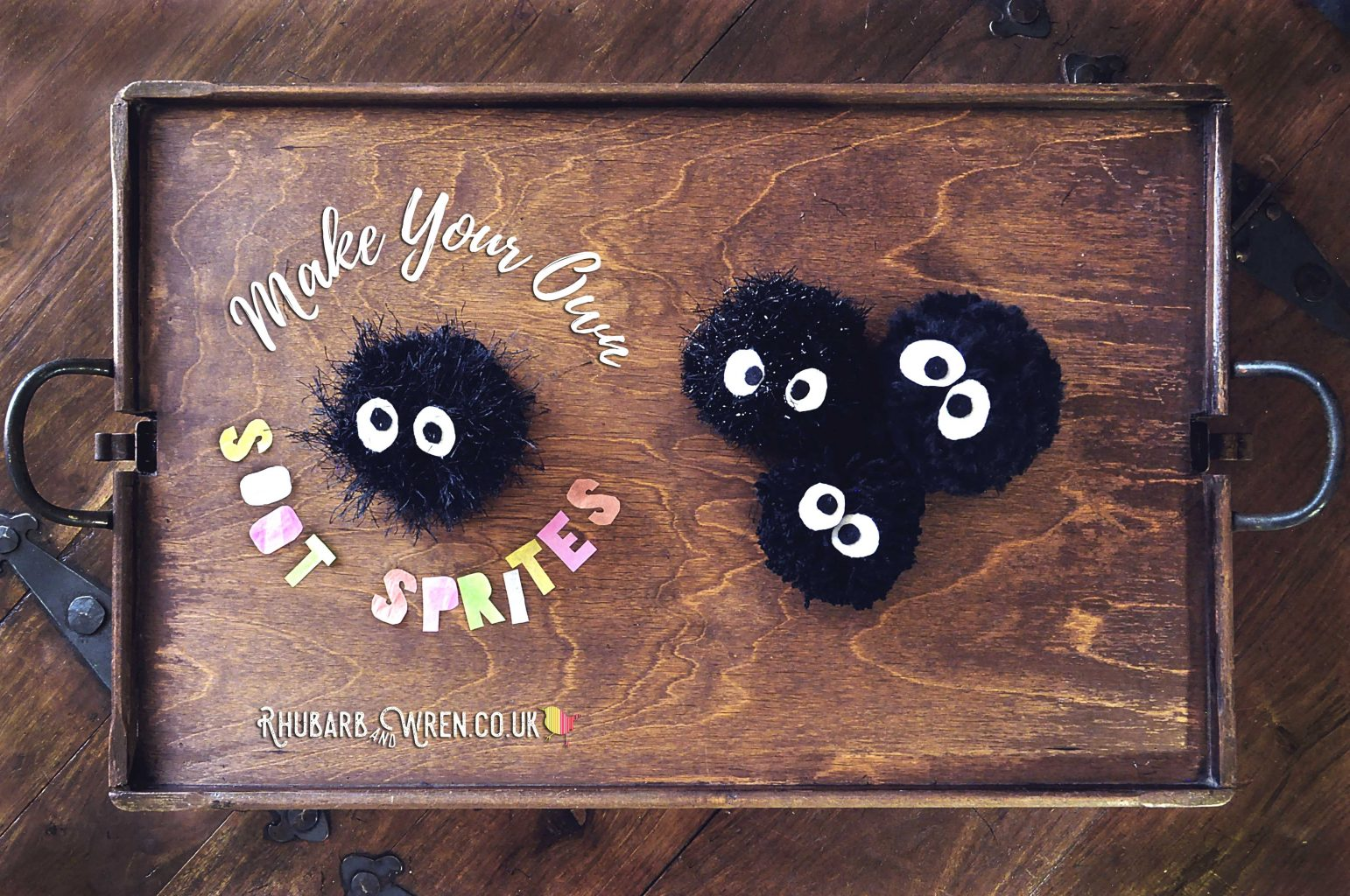 four soot sprite pompoms made using different kinds of wool