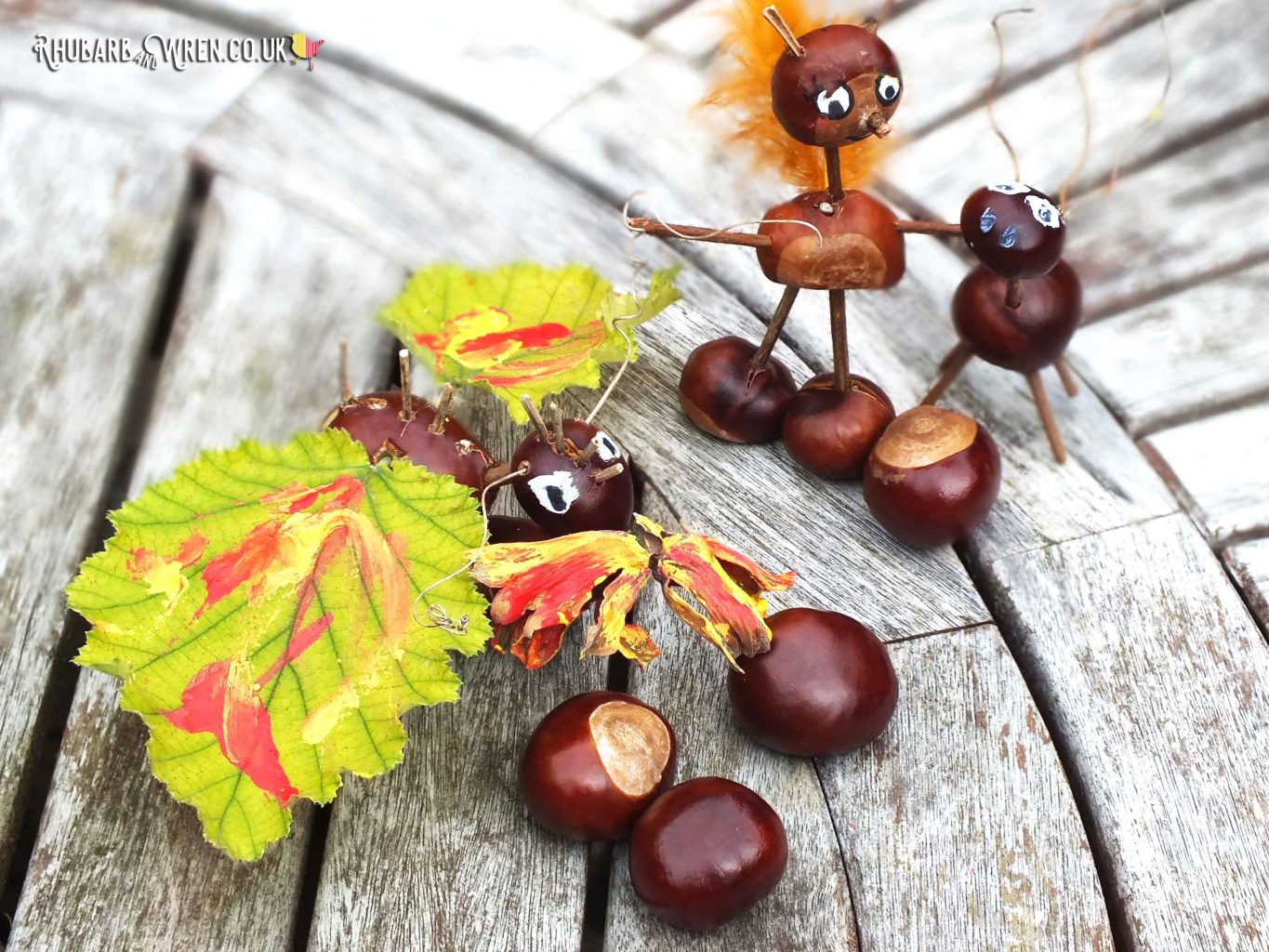 a dragon, squirrel and deer, made out of conkers
