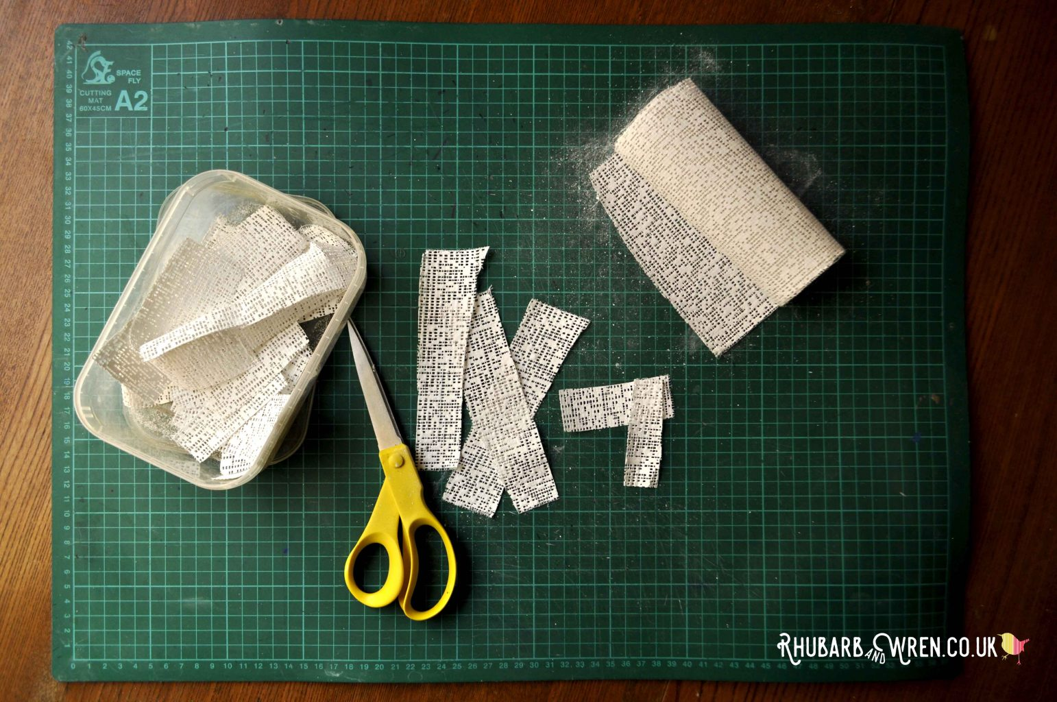 cutting plaster bandages into strips
