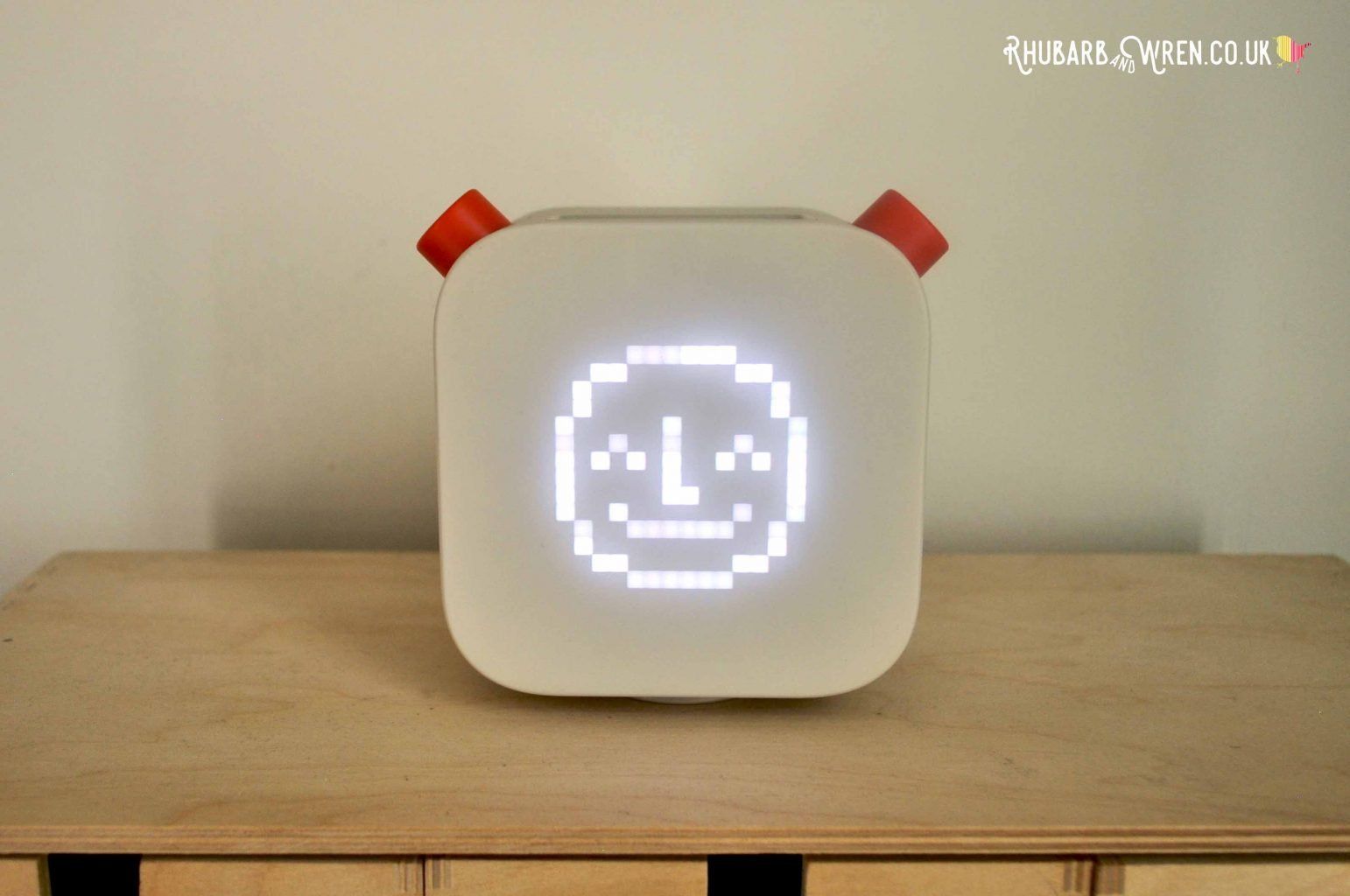 Yoto Player starts up wit  a smiling face on its pixel matrix display