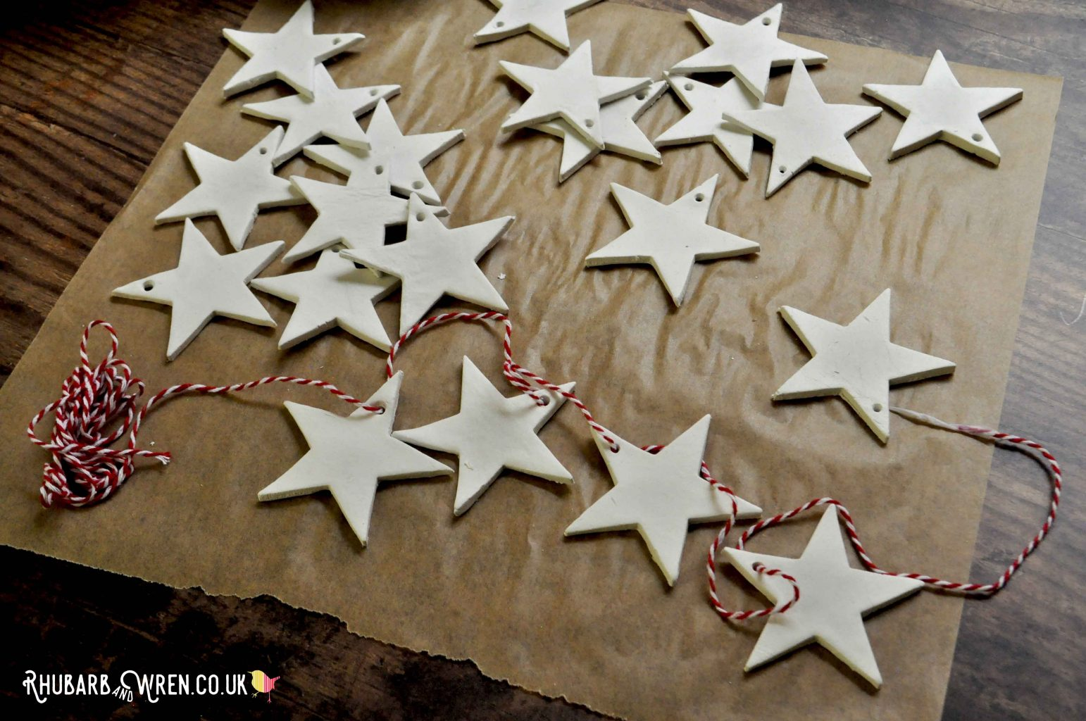 White clay stars threaded onto bakers twine for a DIY Christmas garland.