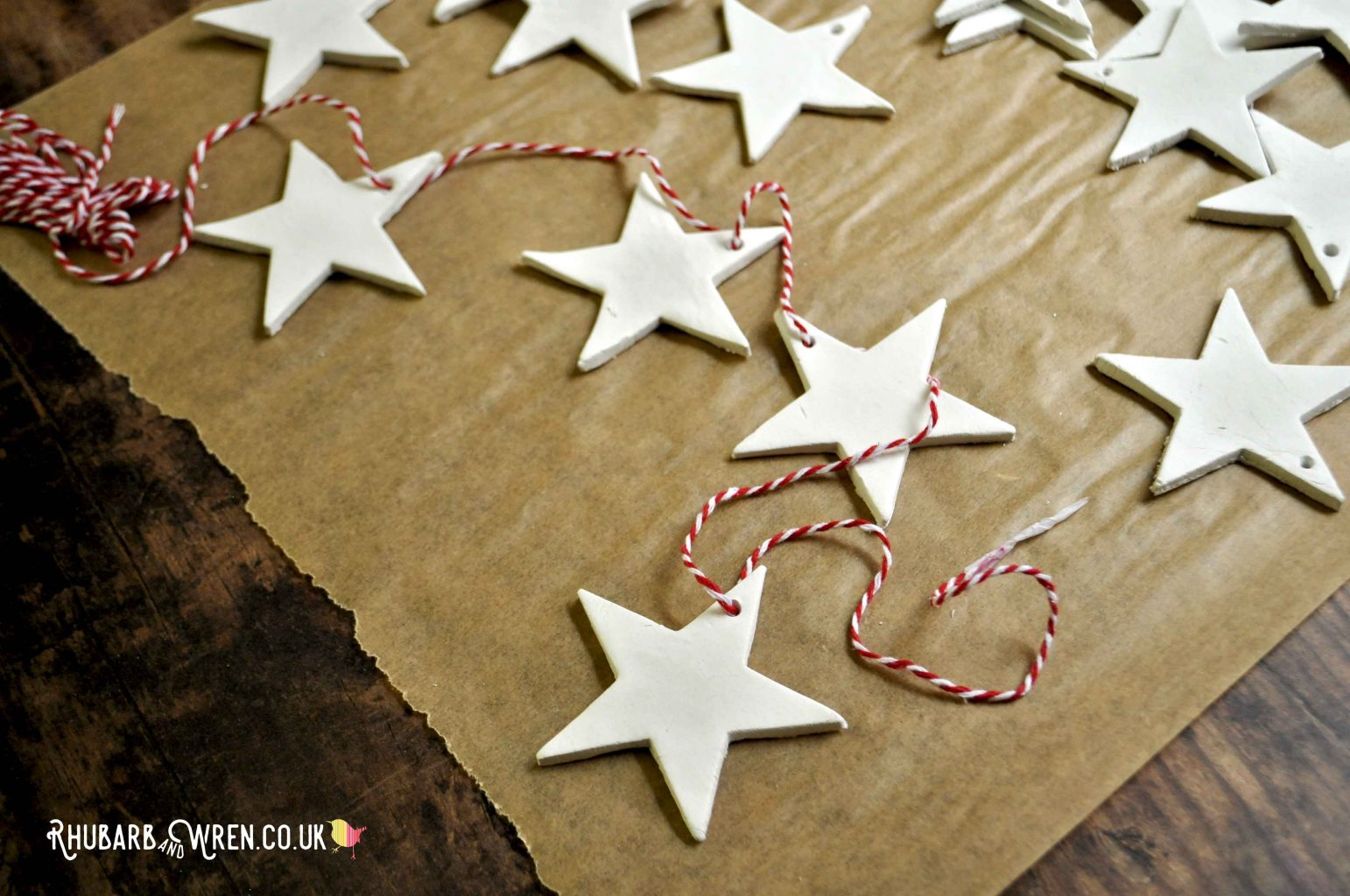 Threading clay stars onto bakers twine to make a Christmas garland