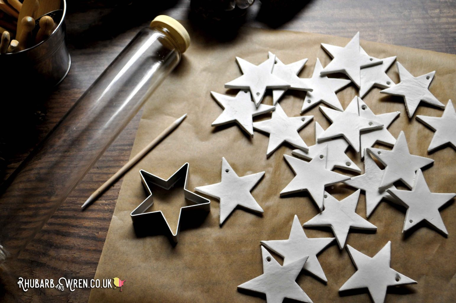 Glass rolling pin and star cutter for making clay star ornaments.